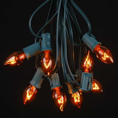 Picture of 25 Light String Set with Amber/Orange Transparent C7 Bulbs on Green Wire