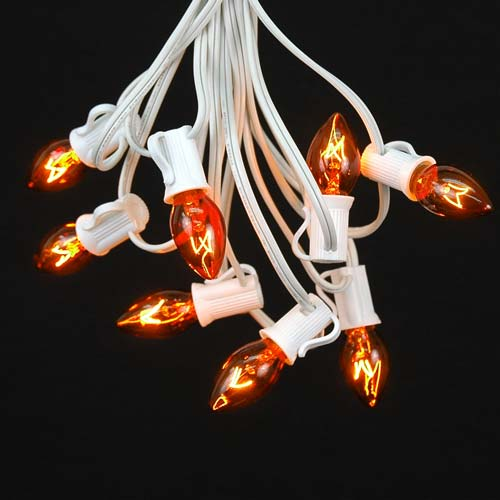 C7 String Lights Outdoor : Amber Transparent C7 Outdoor String Light Set on White Wire - Novelty Lights, Inc