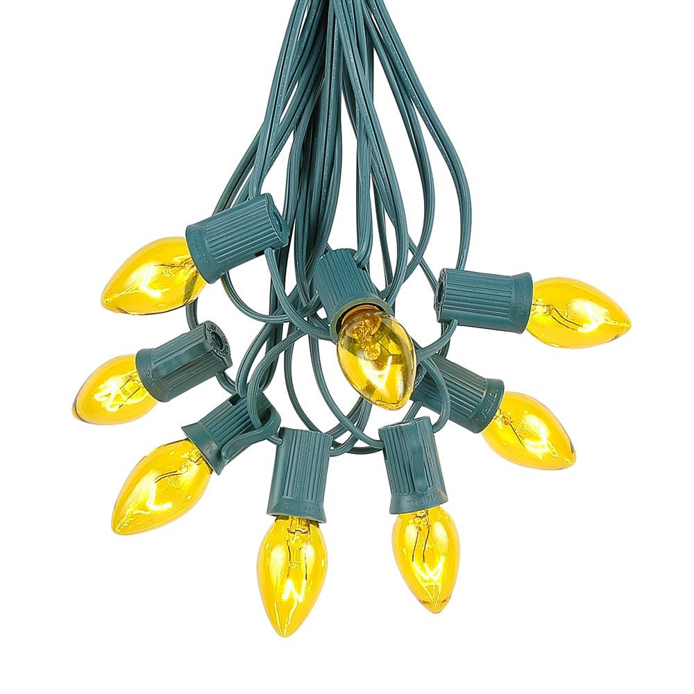 Picture of 25 Light String Set with Yellow/Gold Transparent C7 Bulbs on Green Wire