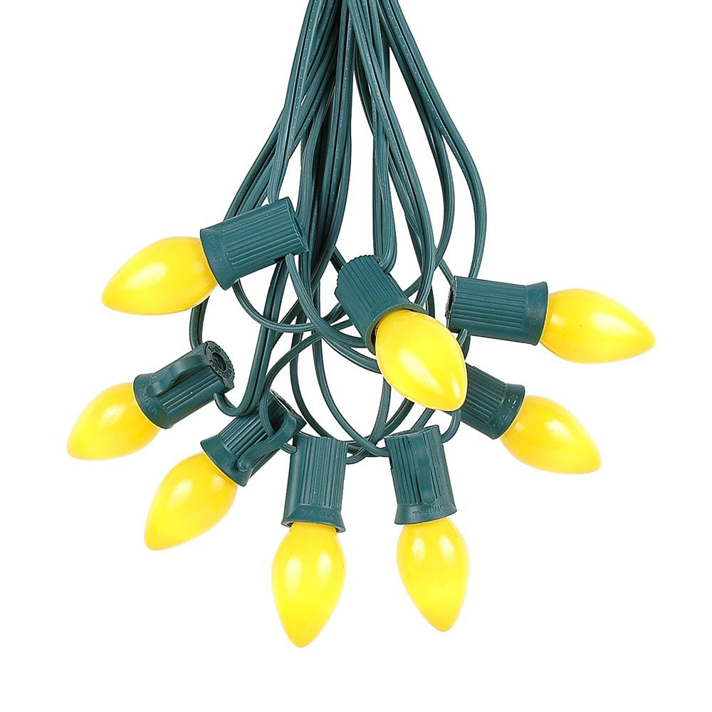 Picture of 100 C7 String Light Set with Yellow Ceramic Bulbs on Green Wire